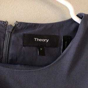 Theory: navy fitted top with side slit.